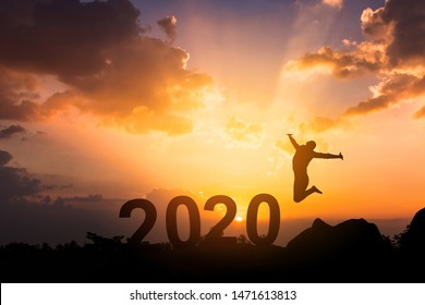 Happy New Year 2020, Silhouette young woman jumping to Happy new year concept.