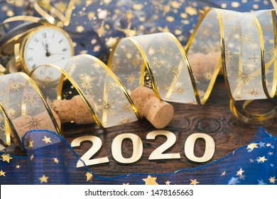 Happy New Year 2020. Symbol from number 2020 on wooden backgroun