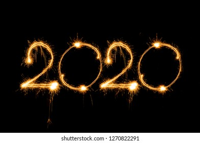 Happy new year 2020 text written with Sparkle fireworks isolated on black background