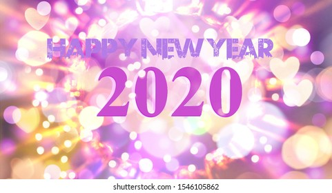 Happy New Year 2020 text on blurred background. Booke rings and stars. Decorated with various beautiful colors. In the jpeg format