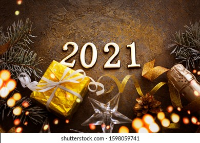 HAPPY NEW YEAR 2021 BACKGROUND OVER DARK STONE TABLE WITH HOLIDAYS DECORATIONS