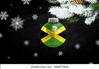Happy new Year 2021, flag of Jamaica on a christmas toy, decorations isolated on dark background. Creative christmas concept.