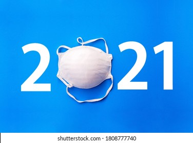 happy new year 2021. 2021 with respirator mask. face mask for virus on blue background