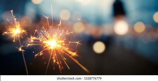 Happy New Year, Burning sparkler with bokeh light background