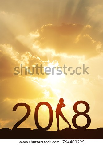 happy new year card 2018silhouette of healthy young woman standing on land watching sunset