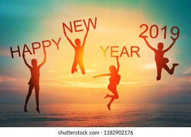 Happy new year card 2019 retro or lomo style. Silhouette of children girl  jumping on tropical beach with vintage sunset sky background. Kids holding the number 2019 with sea and sunrise background.