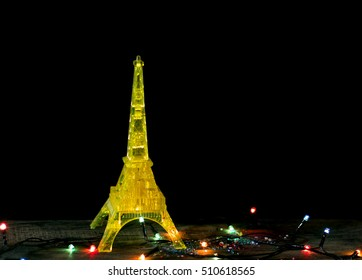 happy new year card with gold yellow model of the eiffel tower in paris old wood