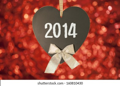 happy new year card on blackboard