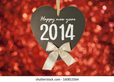 happy new year card on blackboard with red background