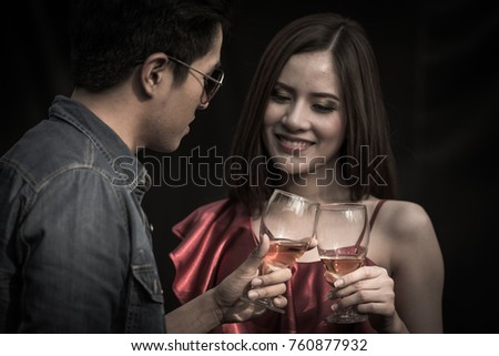 happy new year celebration asia couple hand holding glasses of whisky making a toast and