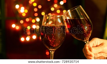 happy new year and christmas 2018 beautiful glasses in hands with wine champagne
