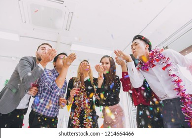 Happy new year colorful party in office business people fun together mix race.