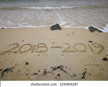 Happy new year concept, 2018 to 2019 written in the sand on a beach