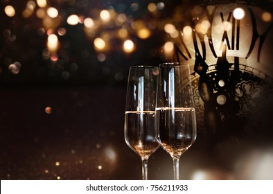 Happy new year congratulations with champagne and a clock