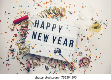 Happy New year displayed on a vintage lightbox with decoration for New Year's Eve, concept image - Shutterstock ID 755594593