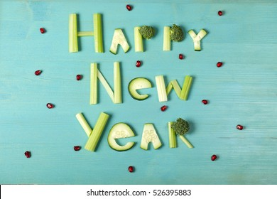 Happy New Year, food lettering, vegetable word on bl wooden background with berries
