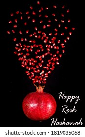 Happy New Year. Fresh pomegranate and seeds decorated on black back ground.