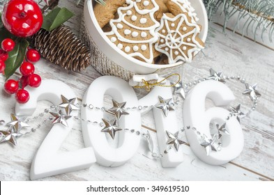 Happy new year with gingerbread cookies on table