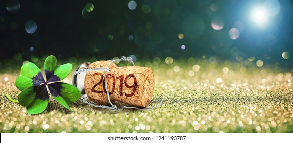Happy New Year. Greeting card with four leaf clover and champagne cork