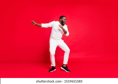 Happy new year guys! Full size photo of funny dark skin man dancing at newyear corporate party wear knitted sweater trousers isolated red background