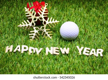 Happy New Year lettering with golf ball and Christmas ornament on green background.