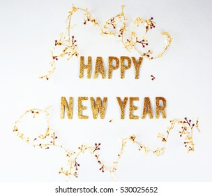 Happy new year message with golden type on a white background.
