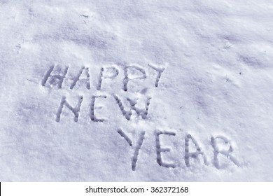 Happy New Year message on a snow field.