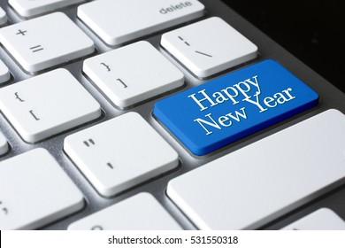 Happy New Year on white keyboard