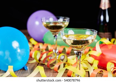 Happy new year party with balloons and streamers and champagne