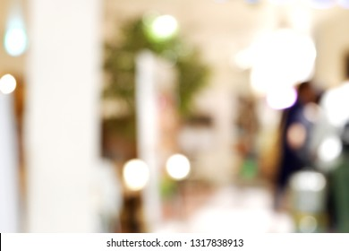 Happy New Year Picture: Blurred abstract background with light bokeh in airport shop - image