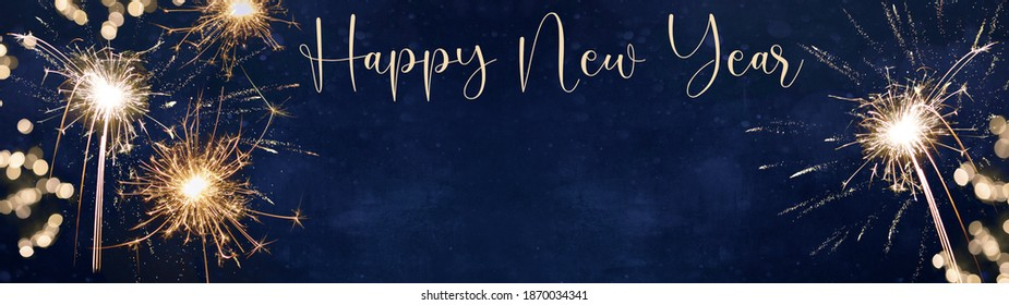 Happy New Year - Silvester background banner panorama long- sparklers and bokeh lights on dark blue night sky texture