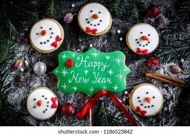 Happy New Year and Snowman cookies,selective focus