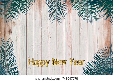 Happy new year vintage leaves on a wooden background