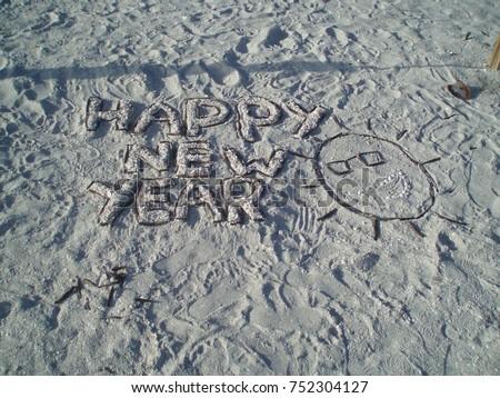 happy new year writing on sanibel island beach florida