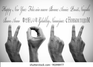 happy new year written in different languages with hands forming number 2012