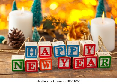 Happy New Year Written With Toy Blocks On Christmas Card Background With Copy Space.