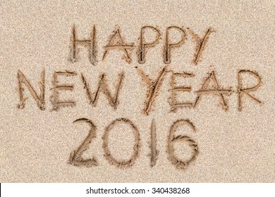 Happy New Years 2016 on the sand backgroung Texture