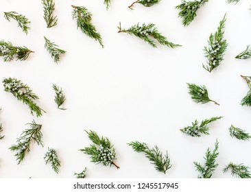 Happy New Year`s concept. Frame made of fir branches isolated on white background.