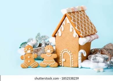 Happy New Year's set of house, gingerbread man in face mask from ginger biscuits glazed sugar icing decoration on blue background, minimal seasonal pandemic winter holiday banner, stay home - Shutterstock ID 1852538239