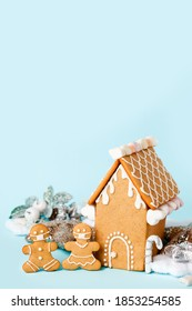 Happy New Year's set of house, gingerbread man in face mask from ginger biscuits glazed sugar icing decoration on blue background, minimal seasonal pandemic winter holiday banner, stay home - Shutterstock ID 1853254585