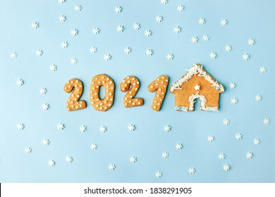 Happy New Year's set of numbers 2021 from ginger biscuits and house glazed sugar icing decoration on blue background, minimal seasonal winter holiday card, banner, flyer, coupon, stay home - Shutterstock ID 1838291905