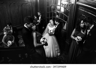 Happy newlyweds and beloved couples in the hall