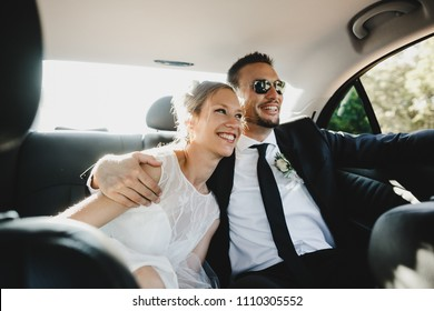 Happy newlyweds ride in the car