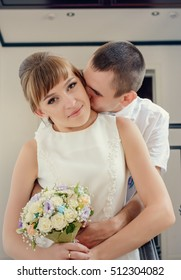 Happy newlyweds share an intimate embrace with joyful smiles , close up upper body portrait