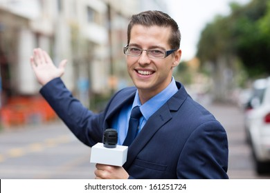 happy news reporter in live broadcasting on street