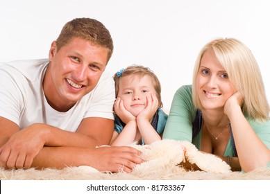 happy nice family lying on a carpet