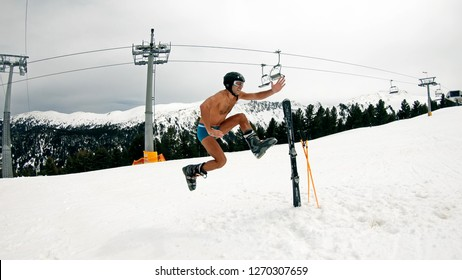 Happy Nude Male Have Fun Jump and Dance at Day Ski Slope Music Party