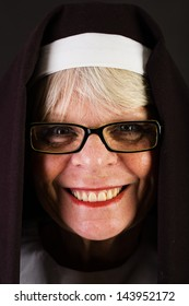 A happy nun with a friendly smile