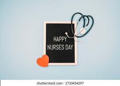 HAPPY NURSES DAY background, banner. International Nurses Day Healthcare and medical concept with notebook, red heart and stethoscope on blue table background.