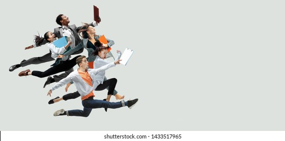 Happy office workers jumping and dancing in casual clothes or suit with folders isolated on studio background. Business, start-up, working open-space, motion and action concept. Creative collage.